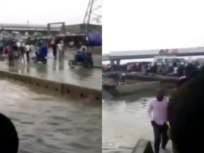 SHOCKING: Lagosians Pay N50 To Cross Flooded Road After Heavy Rainfall 2