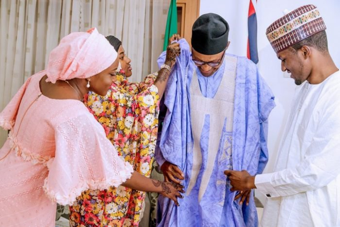 President Buhari Being Dressed By His Children In Daura (Photos) 1