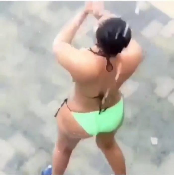 One Word For This! Lekki Slay Queen Seen Bathing Outside Under The Rain (Photos) 1