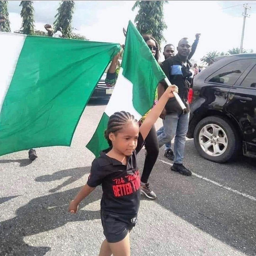 #ENDSARS: She Did It For Next Generation – See The 7 Year Old Girl Who Raised The Nigerian Flag And Led March To Protest