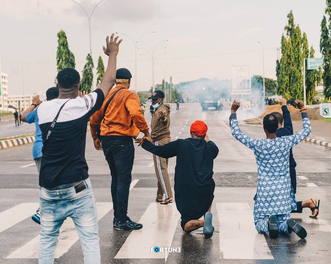EndSARS: The Moment Davido Knelt Down With His Hands Up In Abuja (Photos)
