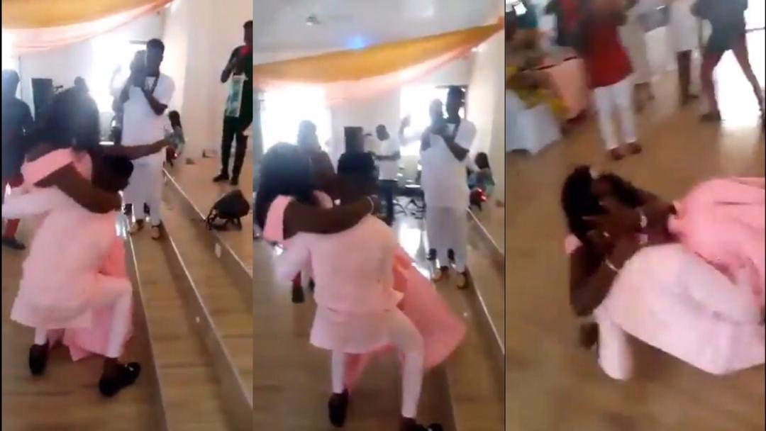 Moments When A Groom Falls Down With His Over-Sized Wife After He Tried To Carry Her