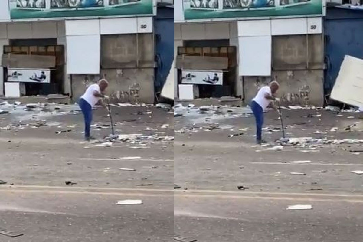 Elderly Woman Volunteers To Clean Up The Street Trashed By Looters In Surulere (VIDEO)