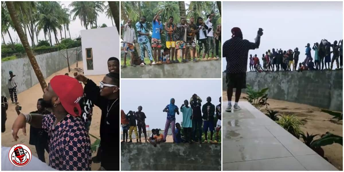 Free Concert: Davido Gets Group of Kids Excited As He Performs for Them on the Fence of His Beach House